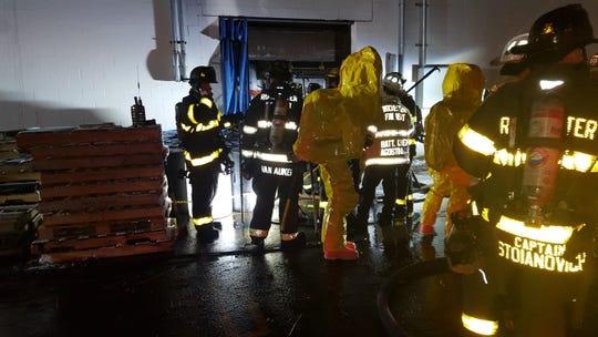 Rochester firefighters battle a blaze on Lagrange Avenue on Monday.