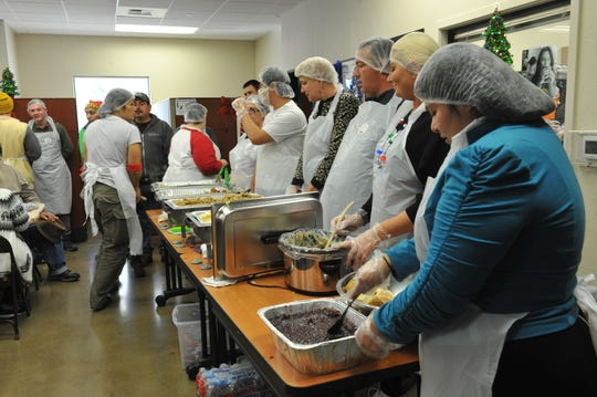 The lunch line where OMNI volunteers prepared and served meals to attendees.