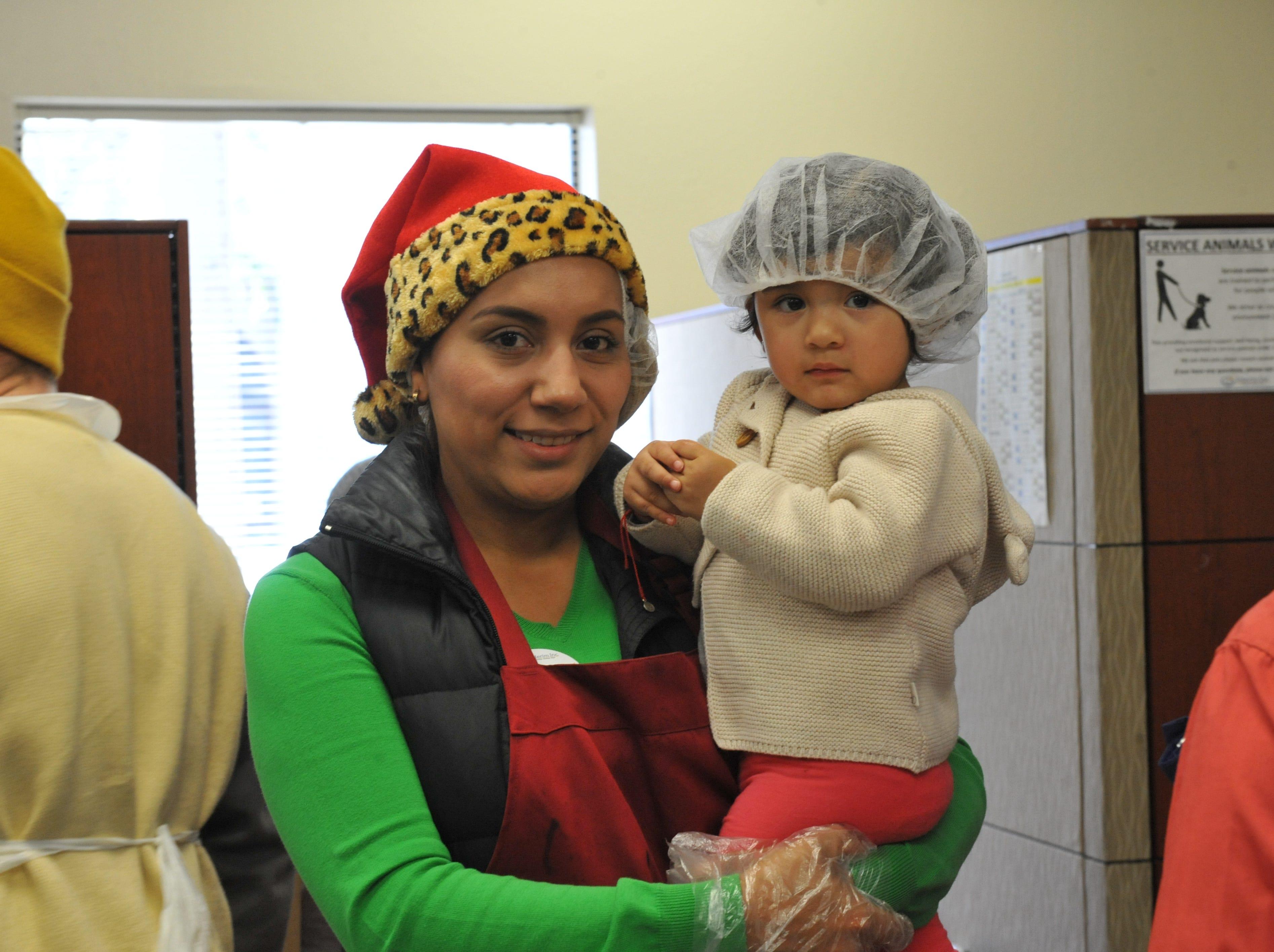 Volunteers Natalia and Mia Jimenez at the OMNI holiday lunch.