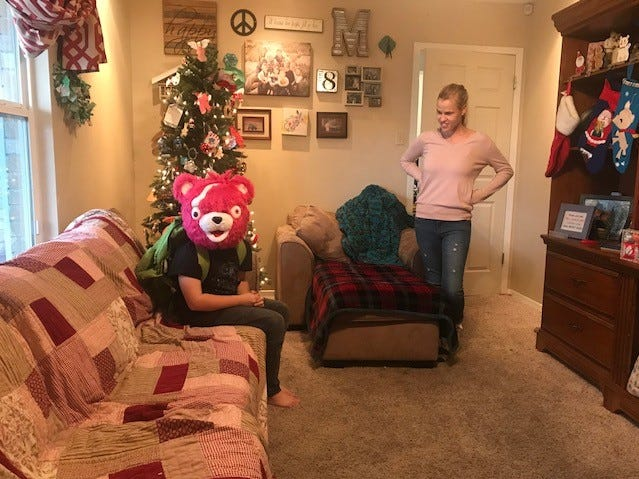 Ashley Martin laughs at her son Canyon Martin as he poses for a picture on Christmas day 2018.