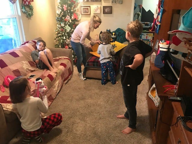 Canyon Martin, his mother, Ashley Martin, and his siblings sorting out Christmas presents Dec. 25, 2018.
