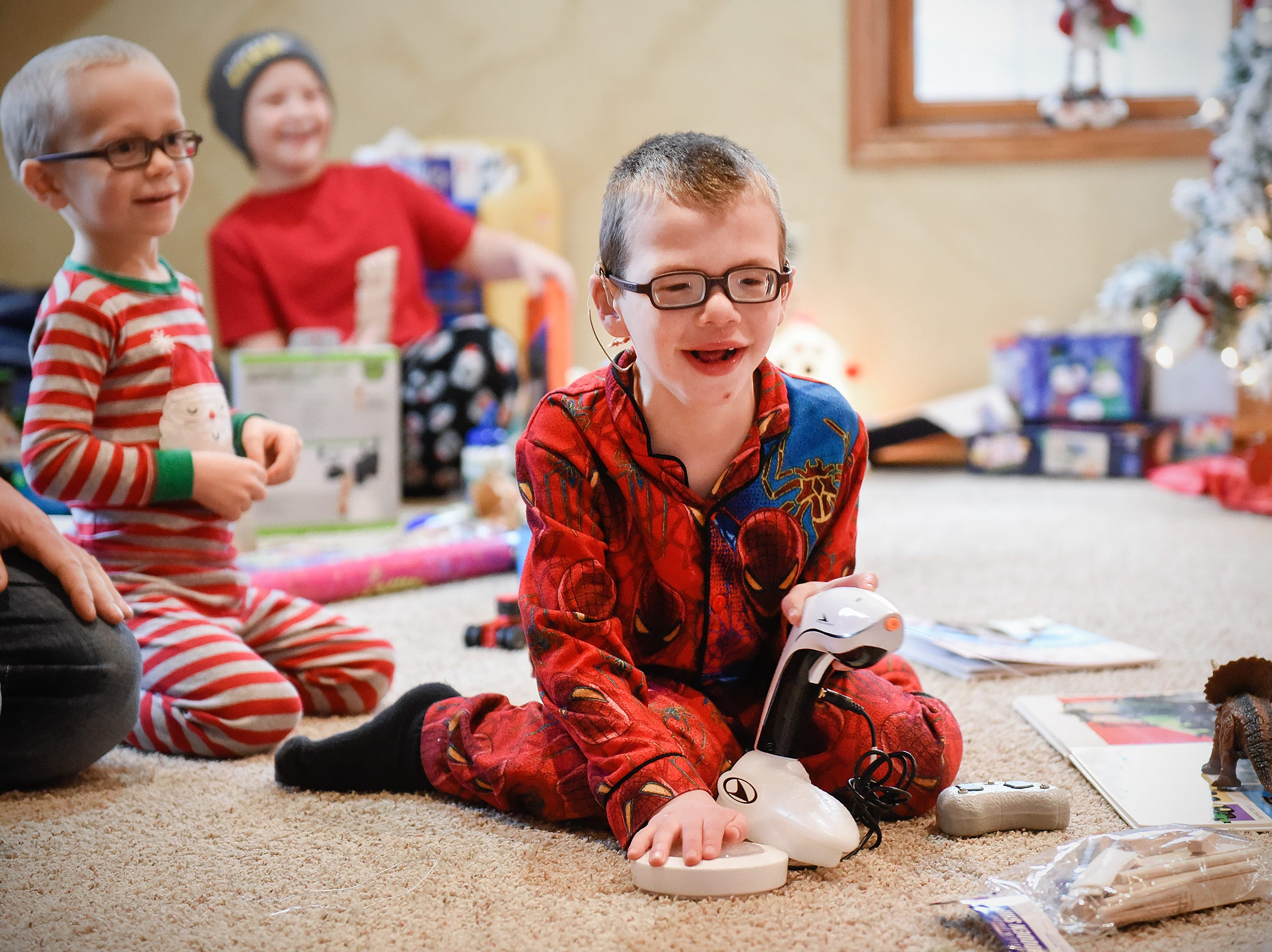 Camran Schneider, 6, plays with his new adapted squirt gun which was an special gift from Santa and Mrs. Claus Tuesday, Dec. 25, at his home in Kimball.