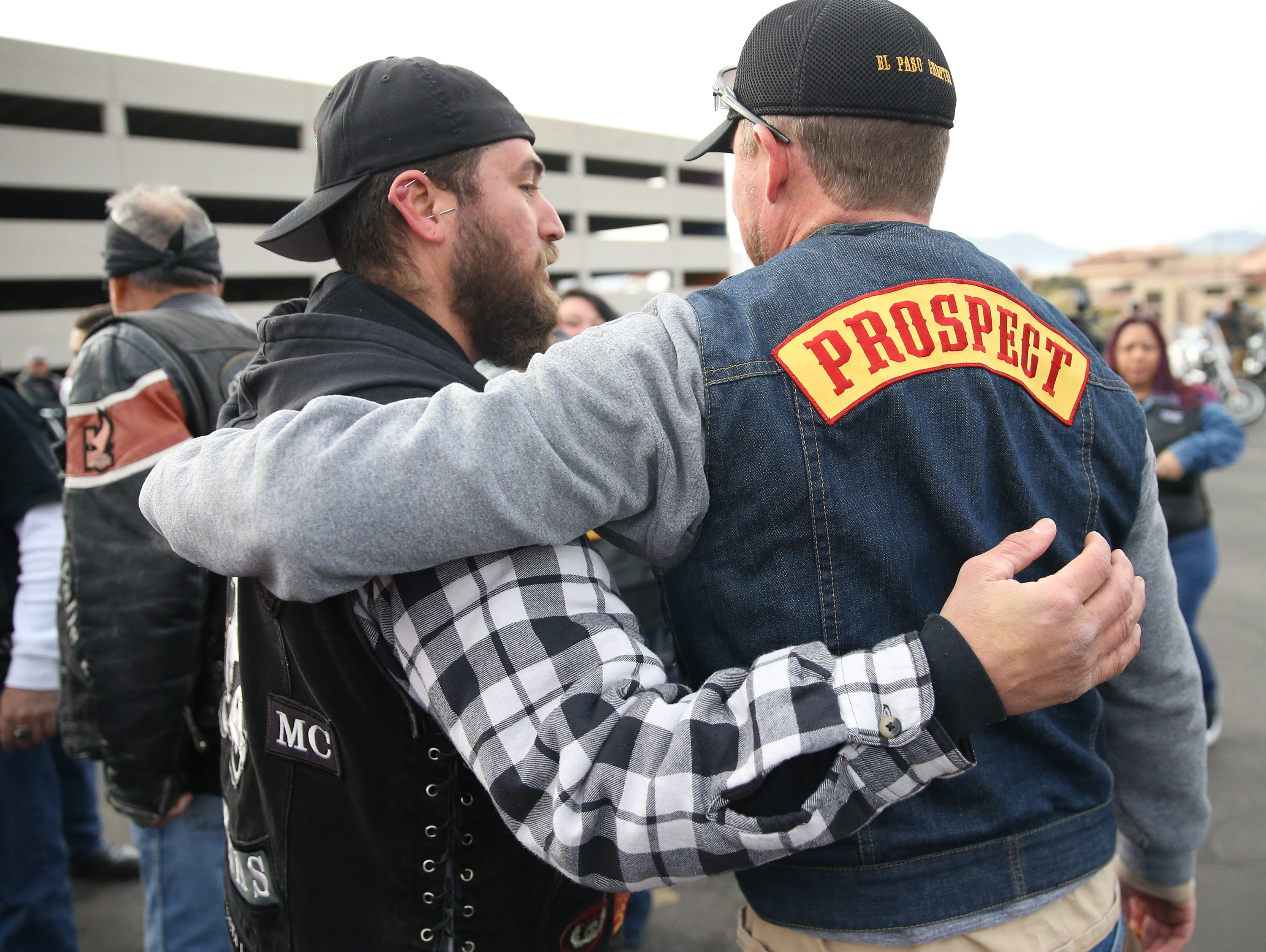 Members of the El Paso Motorcycle Coalition greet each other outside Providence Children's Hospital on Christmas Day.