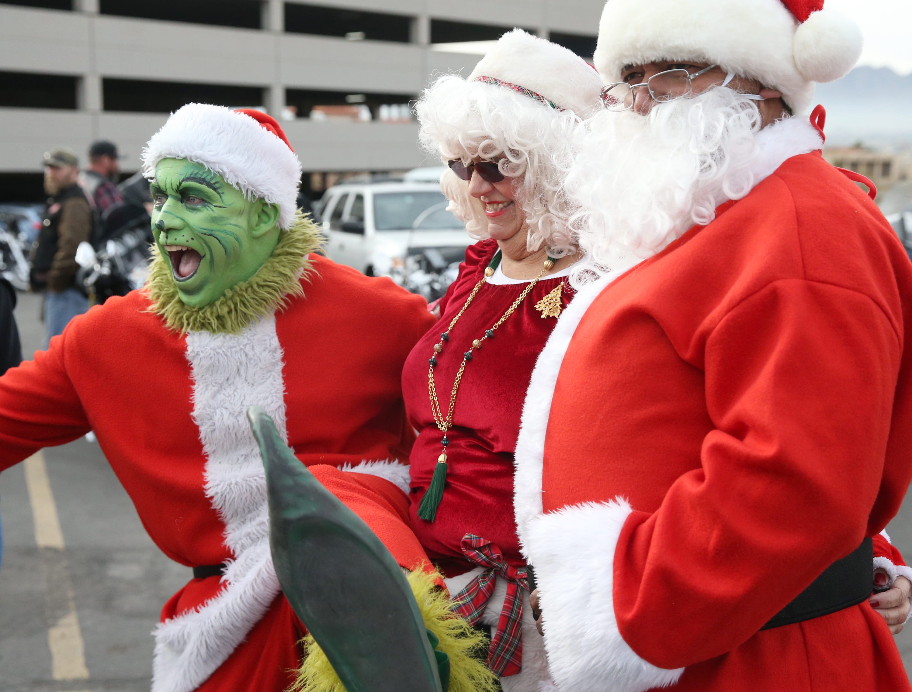 The Grinch was true to himself as he played around with Santa and Mr. Claus outside Providence Children's Hospital on Christmas Day.
