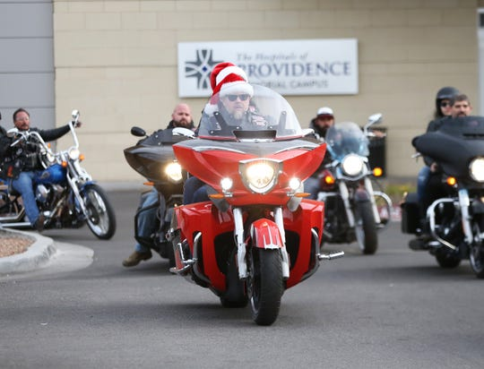 Members of the El Paso Motorcycle Coalition deliver toys to young patients at Providence Children's Hospital on Christmas Day.
