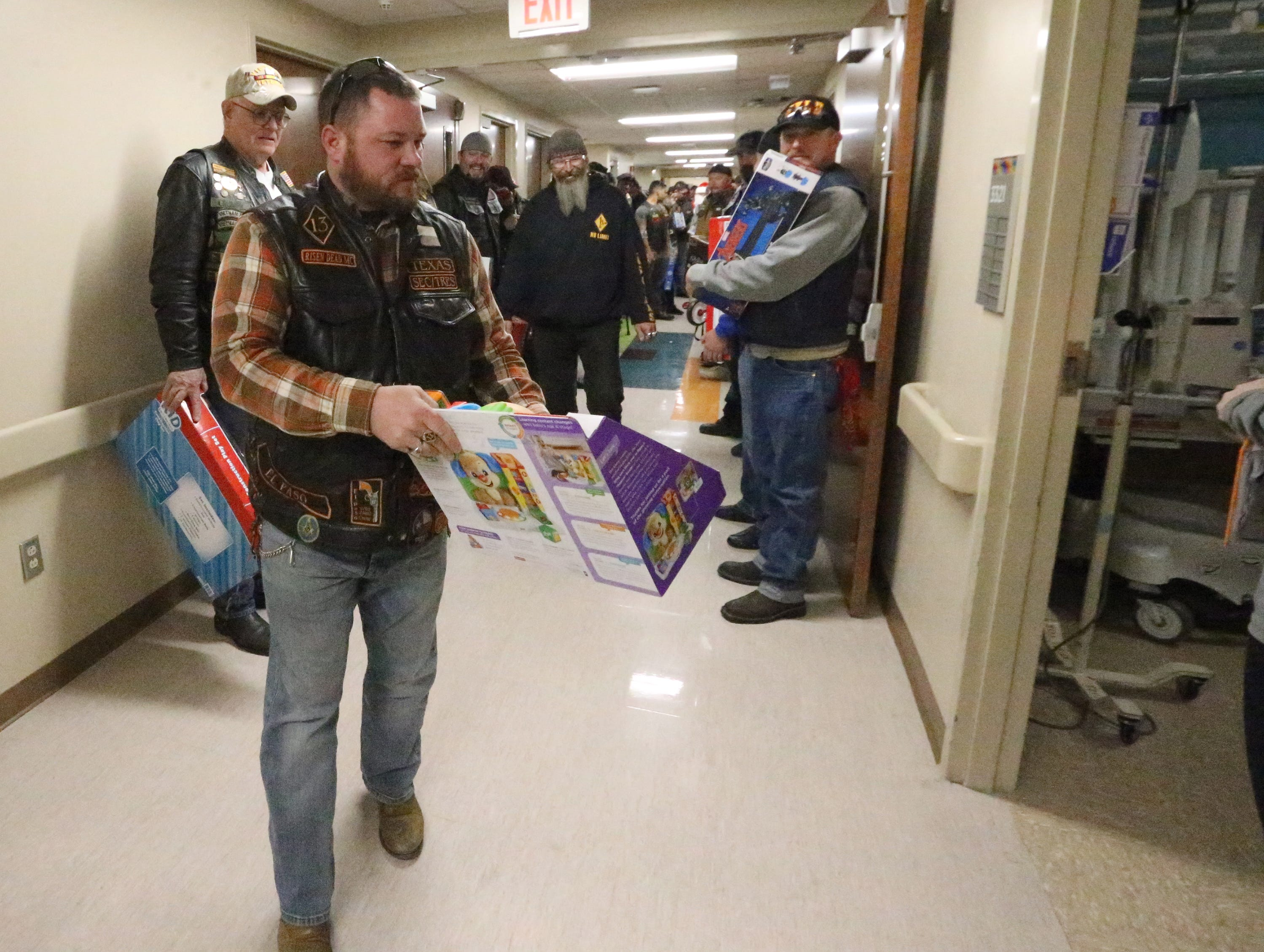Members of the El Paso Motorcycle Coalition deliver toys to children at Providence Children's Hospital on Christmas Day.