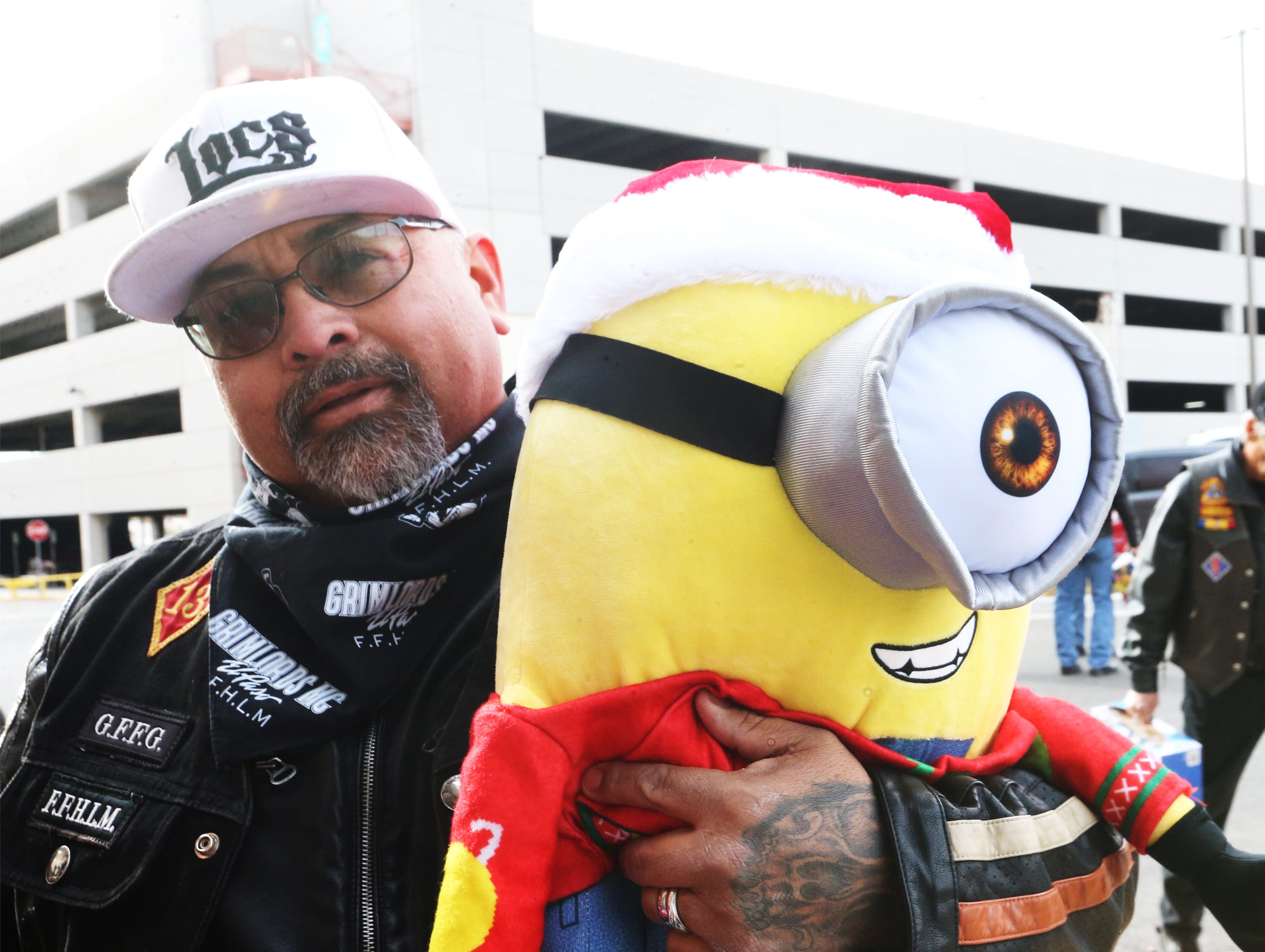 Adrian Villalpando carries a large stuffed toy into Providence Children's Hospital on Christmas Day.