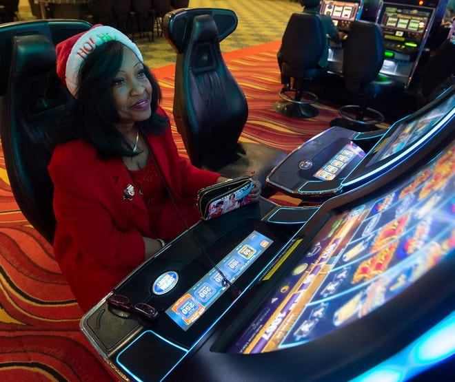 Lisha Smith of Bowie, Md., plays a video lottery game at Dovers Downs Hotel & Casino in Dover.   This is the first time the casino was open on Christmas day.