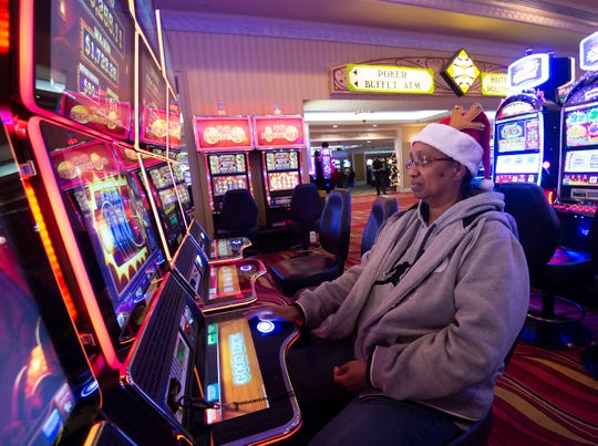Debbie Young of Milford plays a video lottery game at Dovers Downs Hotel & Casino in Dover.   This is the first time the casino was open on Christmas day.