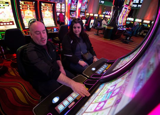 Mike Masiello and Anna Dipisa of Easton, Md., play video lottery games at Dovers Downs Hotel & Casino in Dover.   This is the first time the casino was open on Christmas day.