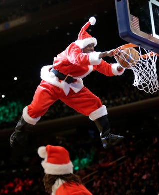 fd8f3518b A performer dressed as Santa Claus dunks the ball during a break in the  first half
