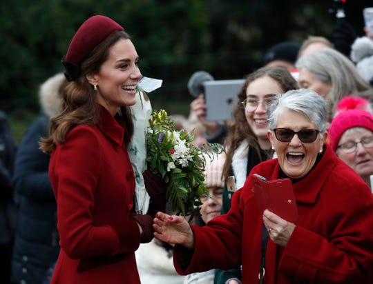 British Kate, Duchess of Cambridge, laughs as she meets members of the audience after attending Christmas service at the St. Mary Magdalene Church at Sandringham in Norfolk, England, Tuesday, December 25, 2018.
