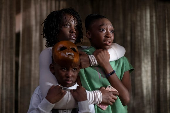 "Adelaide (Lupita Nyong'o) protects her children (Evan Alex and Shahadi Wright Joseph) from sinister invaders in ""Us."""