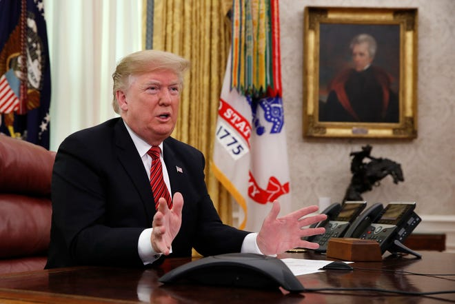 President Donald Trump greets members of the five branches of the military by video conference on Christmas Day.