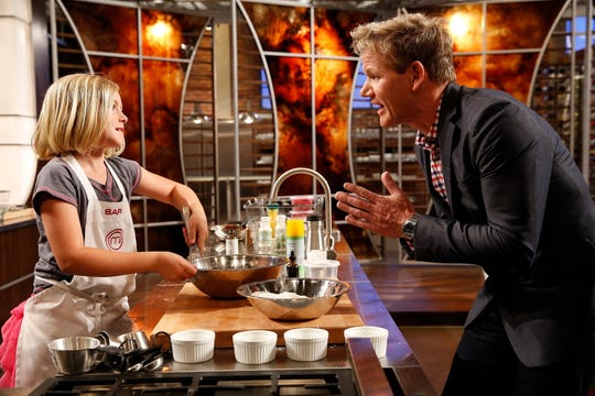 'MasterChef' judge Gordon Ramsay, right, assesses the culinary skills of young chefs on Fox's 'MasterChef Junior.'