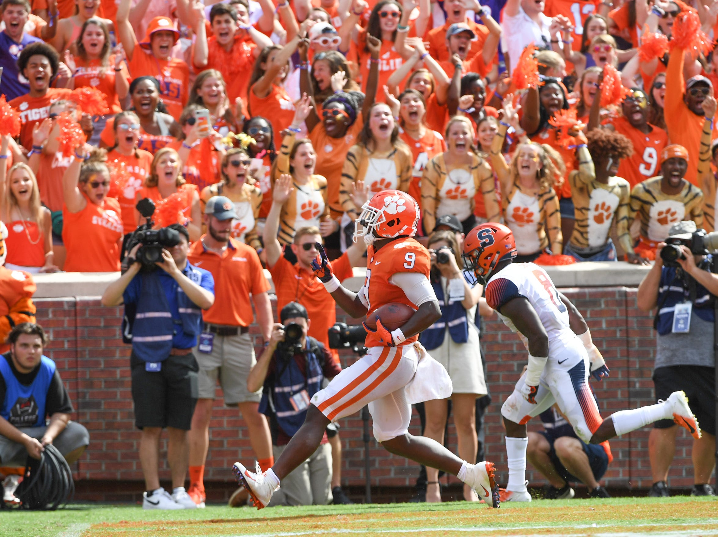 Clemson running back Travis Etienne (9) scores near Syracuse defensive back Antwan Cordy(8) during the fourth quarter in Memorial Stadium on Saturday, September 29, 2018.