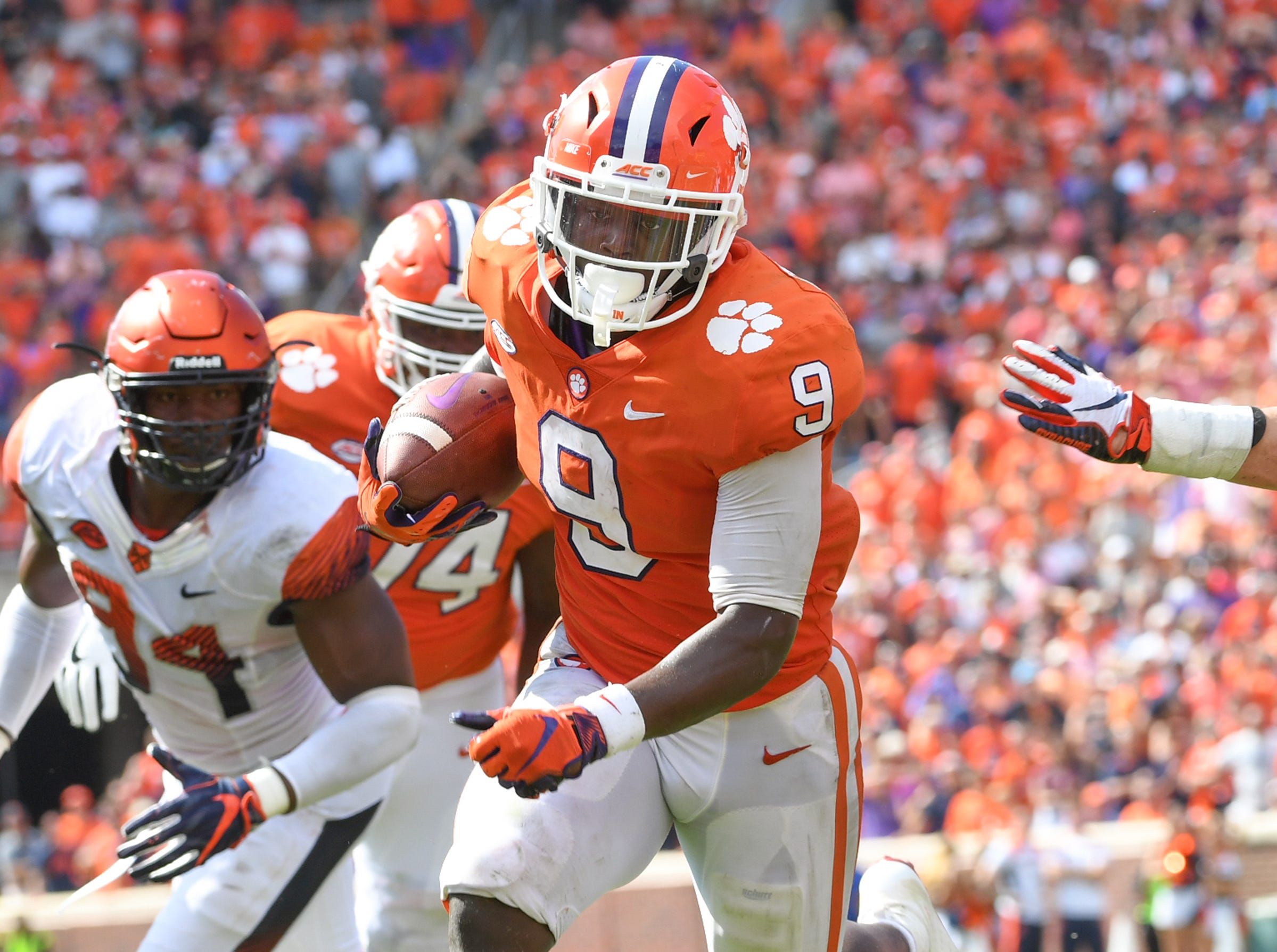 Clemson running back Travis Etienne (9) runs in the go-ahead touchdown against Syracuse during the fourth quarter in Memorial Stadium on Saturday, September 29, 2018.