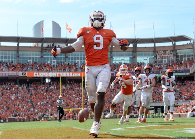 Clemson running back Travis Etienne (9) scores the go-ahead touchdown against Syracuse during the fourth quarter in Memorial Stadium on Saturday, September 29, 2018.