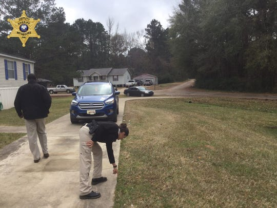 Evidence is gathered at the scene of a fatal shooting in the Grand Ecore area Wednesday morning. A Montgomery man died and another is in serious condition, according to the Natchitoches Parish Sheriff's Office.
