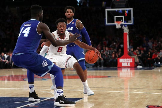 St. John's Red Storm guard Shamorie Ponds (2) is defended by Seton Hall Pirates forward Ismael Sanogo (14) with Myles Powell (background ) looking on last season.