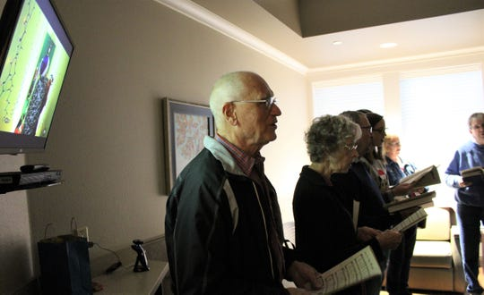Most rooms at Hendrick Hospice Care Center are darkened, with the only light coming from TV sets and doors open to dim hallways. Singers who provide a weekly music ministry use whatever light in available to see their music, if needed.