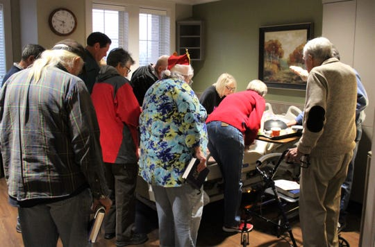 It's not just about singing; a group that each Thursday provides a music ministry at Hendrick Hospice Care Center also prays together for patients.