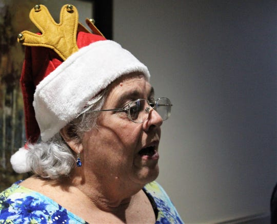 Barbara Kirk wore her favorite Santa hat Dec. 20 for singing at Hendrick Hospice Care Center.