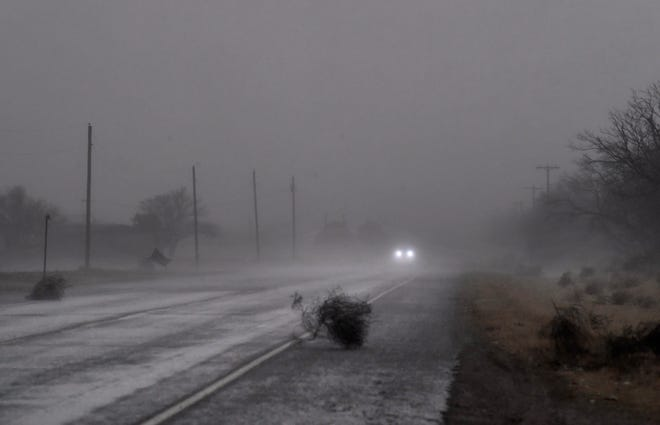 Tumbleweeds blow across State Highway 6 just south of Rule Wednesday as a line of thunderstorms roll through.