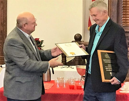 Incoming Shackelford County Judge Bob Skelton presents a proclamation to retiring County Judge Ross Montgomery.