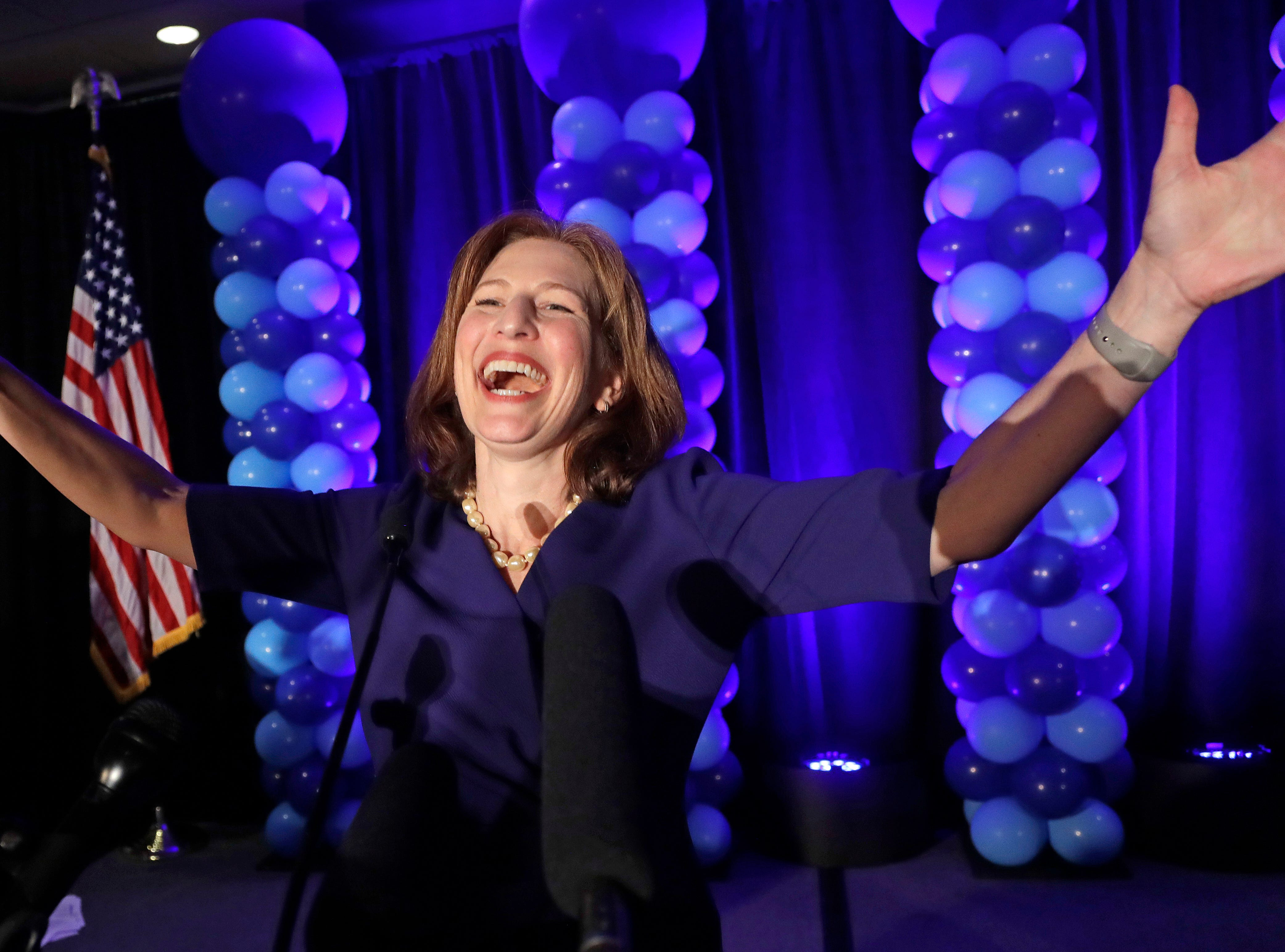 FILE - In this Nov. 6, 2018, file photo, Congressional candidate Kim Schrier addresses the crowd at an election night party for Democrats, in Bellevue, Wash. Schrier's victory in the 8th District was among the state's top news stories of 2018. (AP Photo/Elaine Thompson, File)