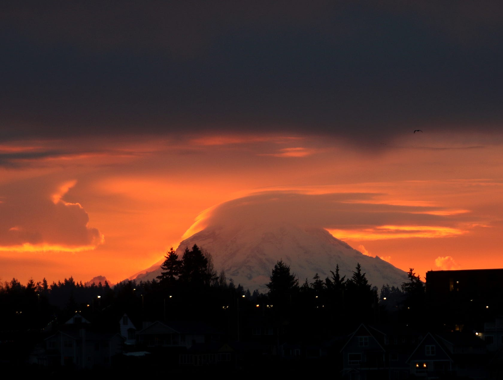 The sunrise lights up Mt. Rainier from Lions Park in Bremerton on December 22, 2018.