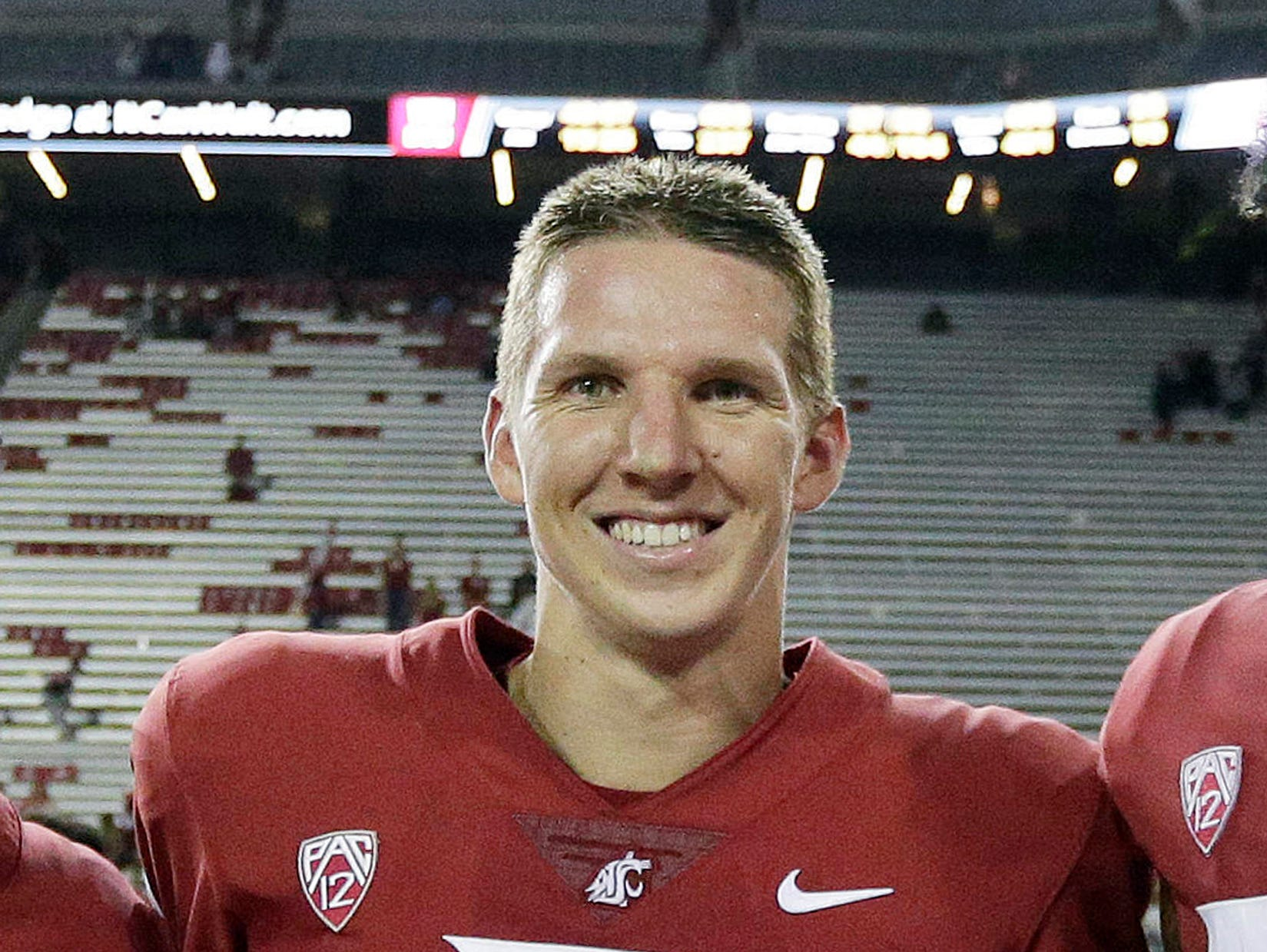 FILE - In this Sept. 9, 2017, file photo, Washington State quarterback Tyler Hilinski poses for a photo after an NCAA college football game against Boise State in Pullman, Wash. Hilinski's death from a self-inflicted gunshot wound was among the state's top news stories of 2018. (AP Photo/Young Kwak, File)