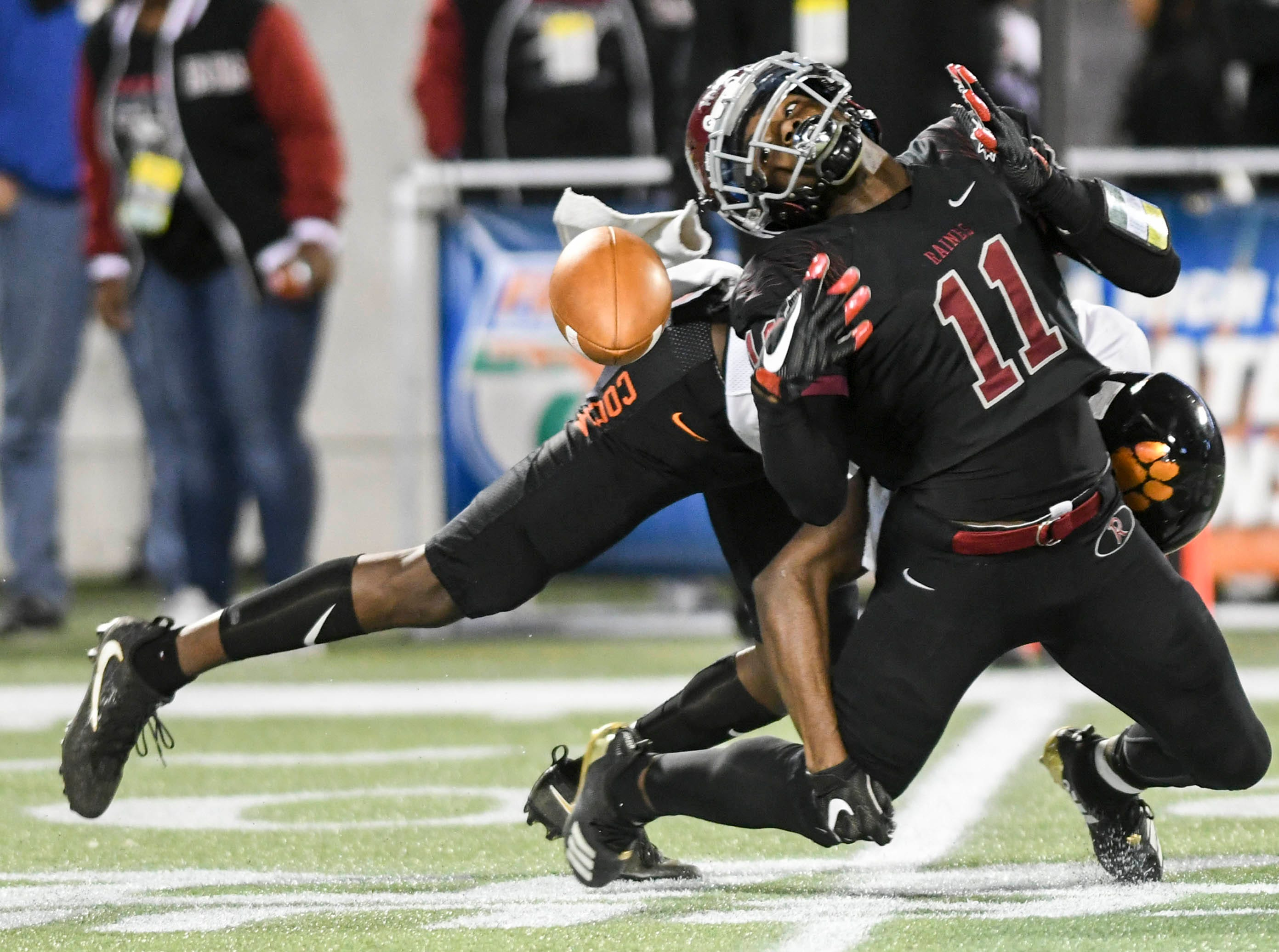 Cocoa's Charlie Thompson breaks up a pass intended for Jamari Williams of Raines (11) during Thursday's Class 4A football state championship.
