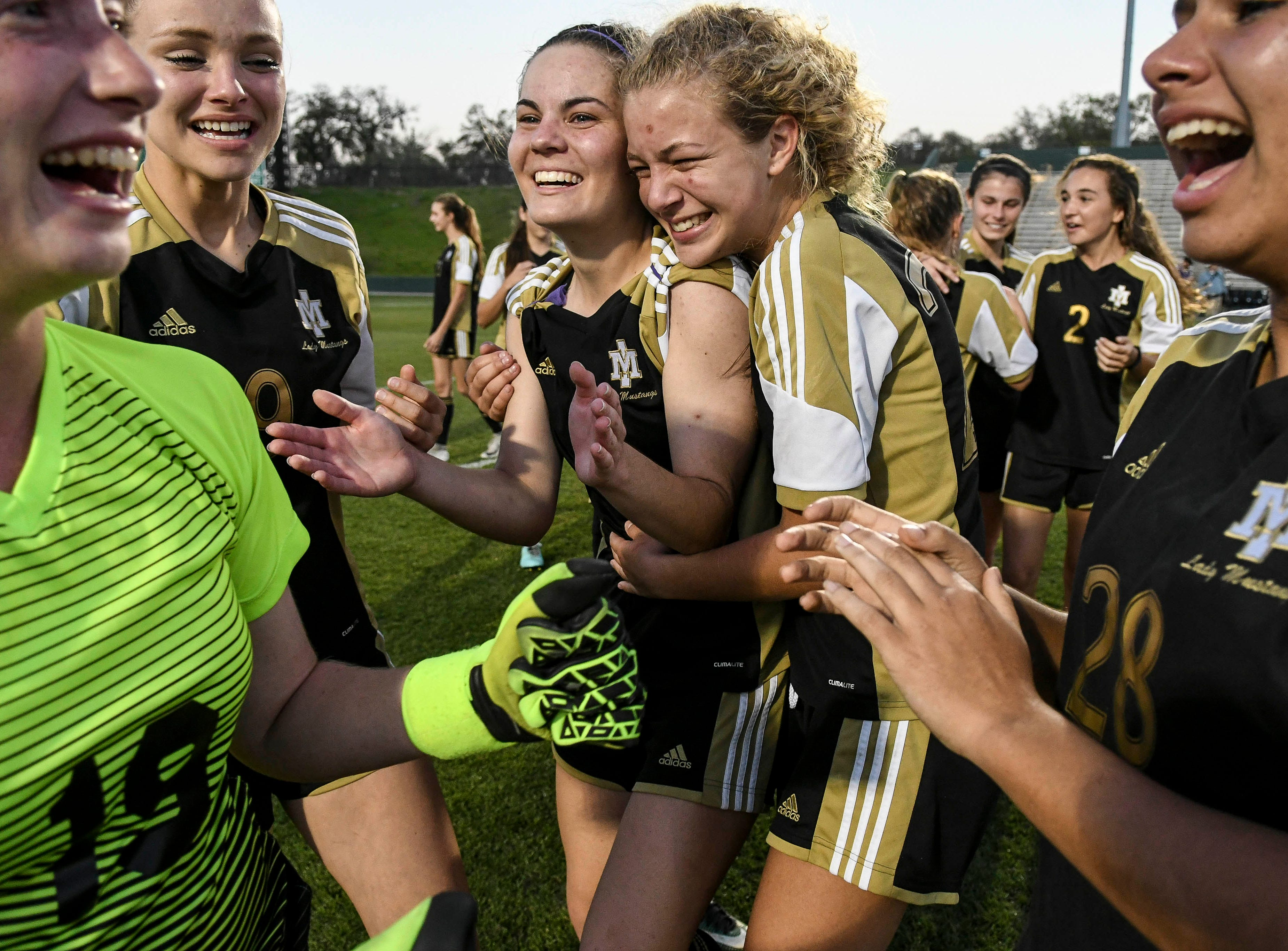 Merritt Island players celebrate their Class 3A soccer championship Friday at Spec Martin Stadium in Deland.