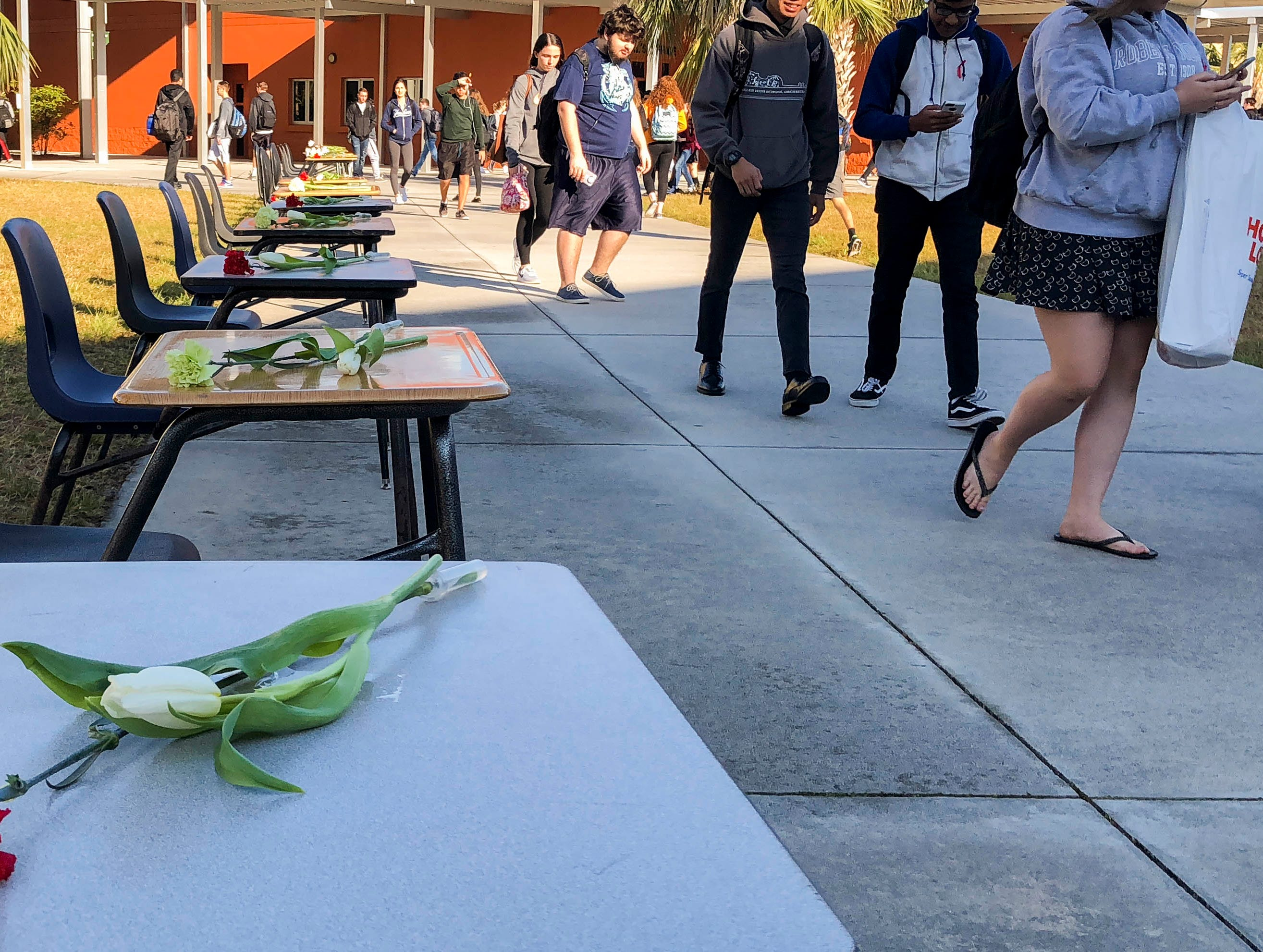 17 chairs and desks set up in the courtyard of Viera High in Viera, FL. One seat for each of the victims at Marjory Stoneman Douglas High School.