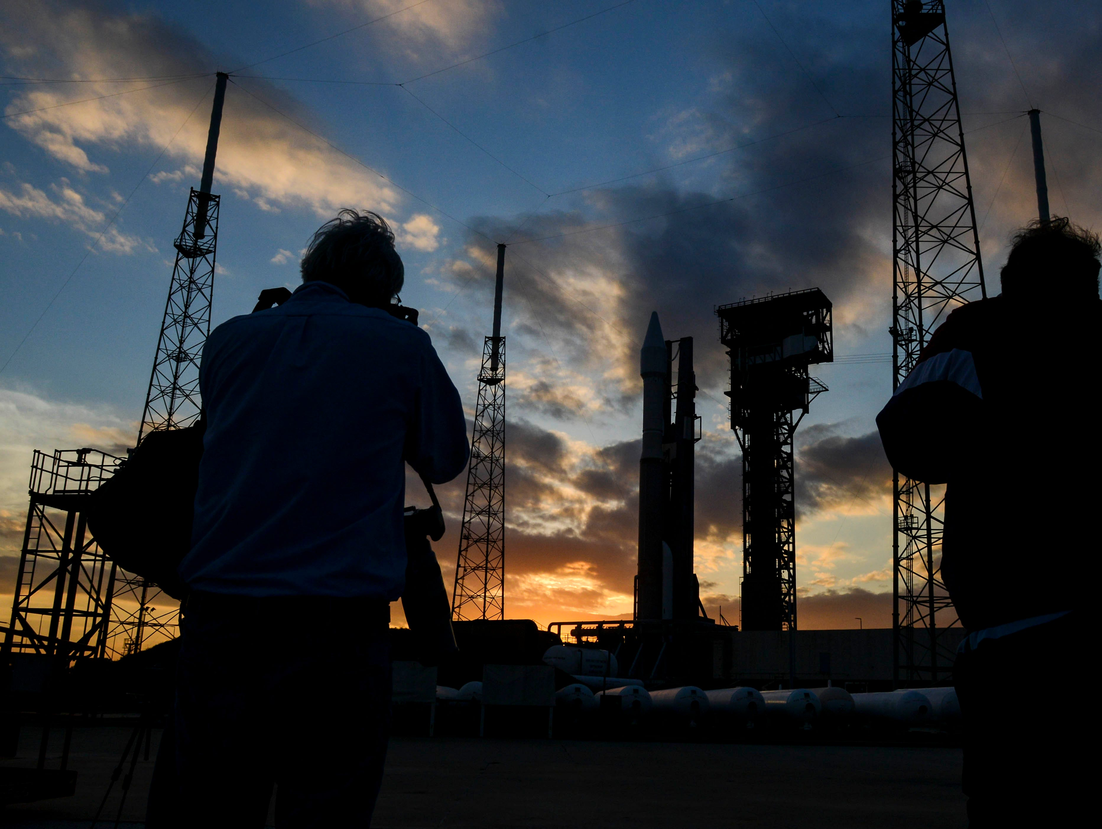 An Atlas V rocket sits on the pad at Launch Complex 41 Wednesday evening as the sun goes down.  The is scheduled to lift off Thursday evening carrying a missile warning satellite for the US Air Force.