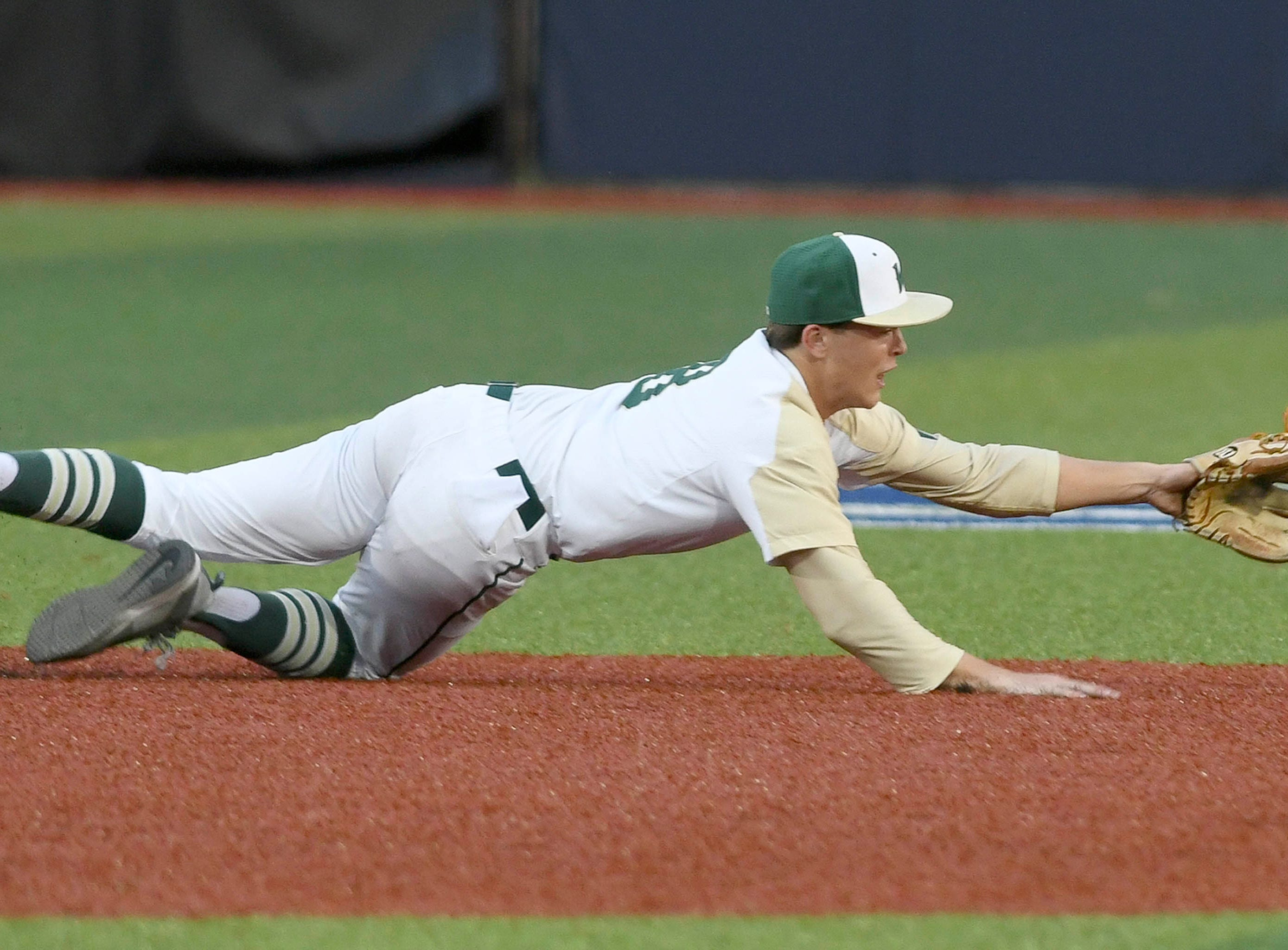 Andrew Brait of Viera dives for a ball during their game against Woodford County Wednesday.