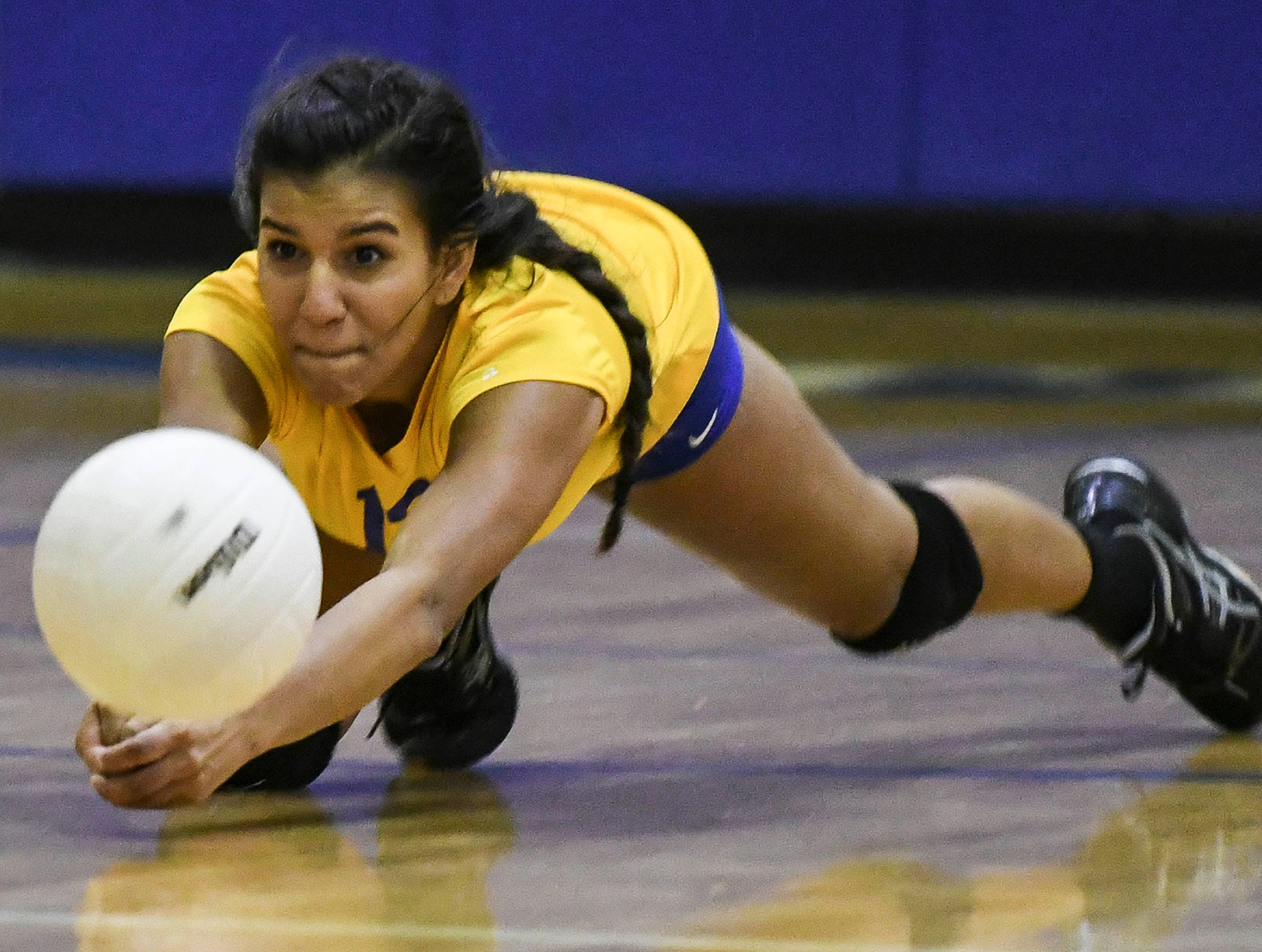 Christy Cavallero of Titusville dives for a ball during their match against Melbourne Tuesday.