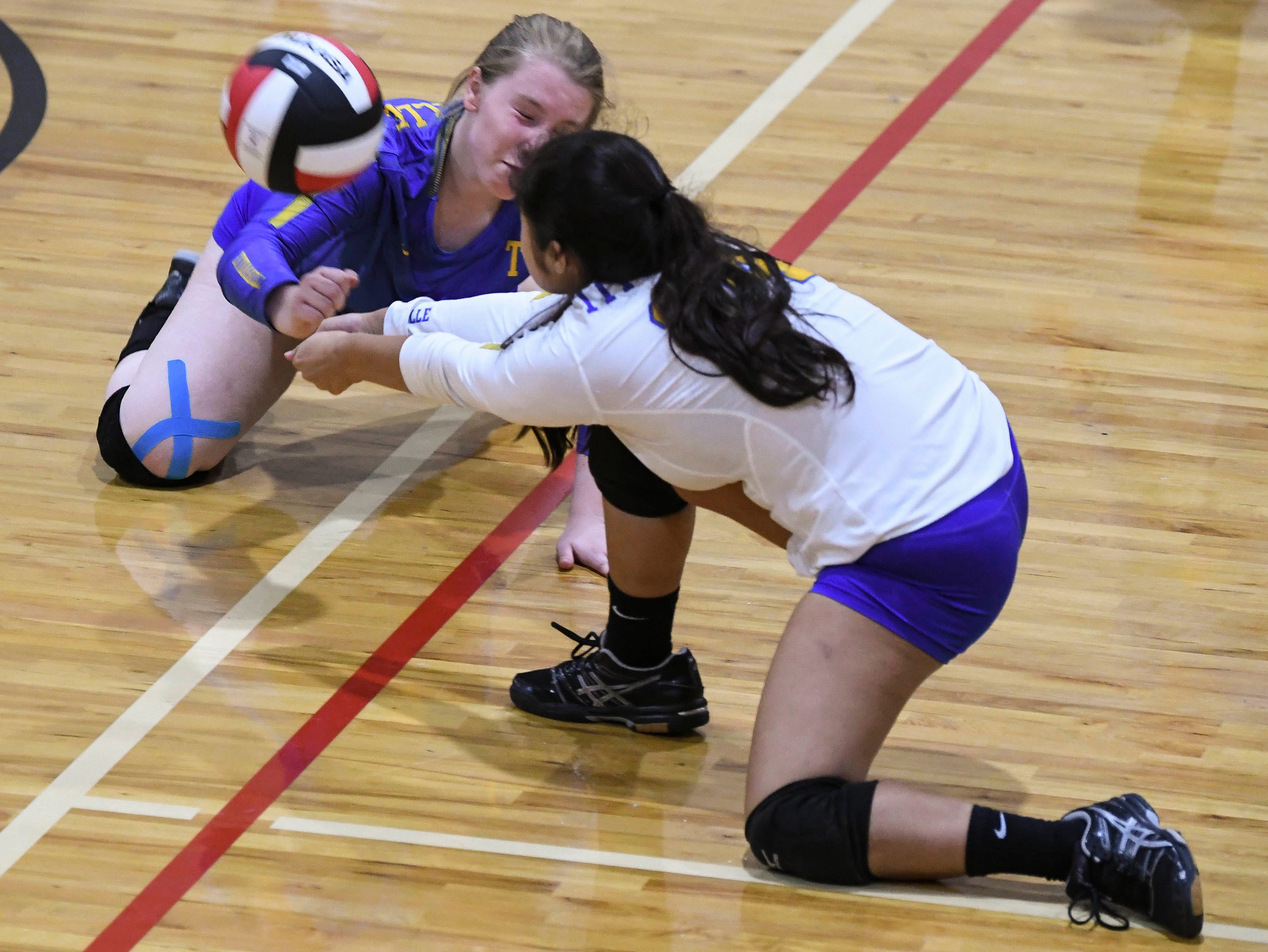 Rochelle Torres and Joella Wahlberg of Titusville collide going for the ball during Thursday's match.