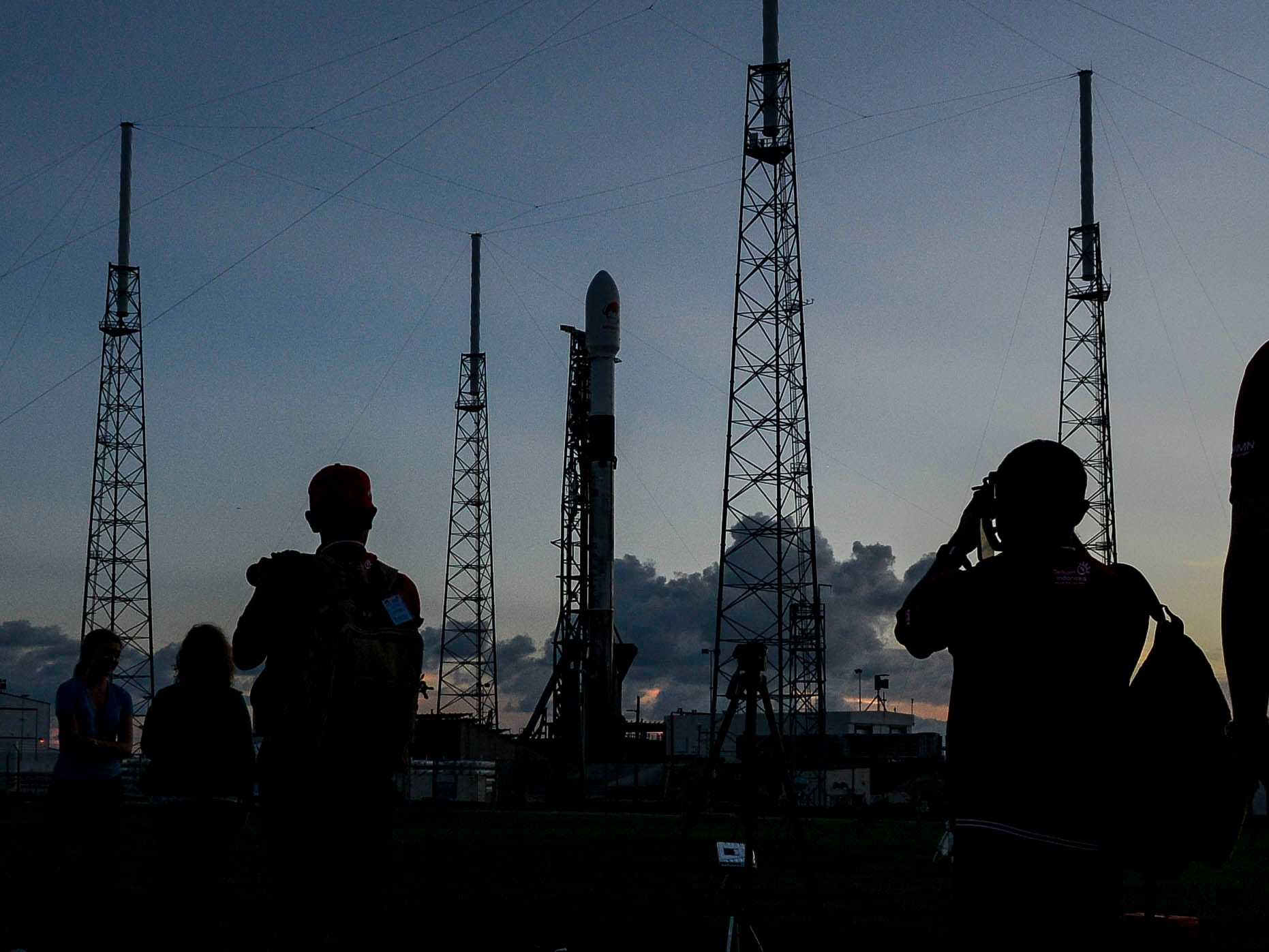 A SpaceX Falcon 9 rocket sits ready to launch at Complex 40 at Cape Canaveral Air Force Station.  The rocket is set to launch early Tuesday morning with an Indonesian communications satellite.