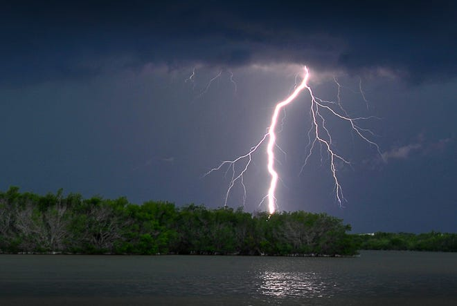 Thunderstorms rolled in over Brevard County Thursday evening with weather alerts and heavy rains. A lightning bolt lights up the sky over the Thousand Islands and the Banana River in Cocoa Beach Thursday evening as the storm passes through.