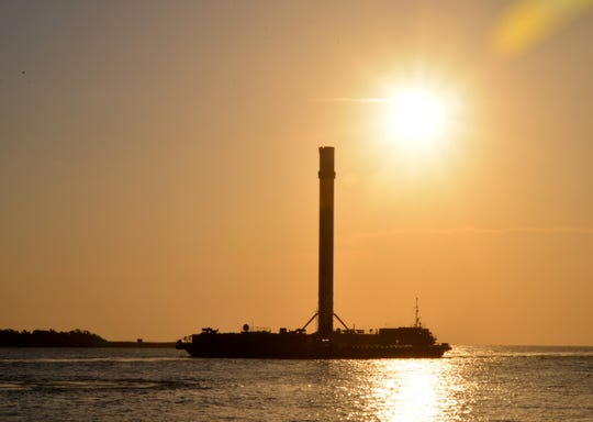 """The booster from the SpaceX Falcon 9 rocket used for Sunday morning's Telstar 19v communications satellite mission launch came in to Port Canaveral approximately 7:15 a.m. Wednesday morning on the drone ship """"Of course I still love you."""""""
