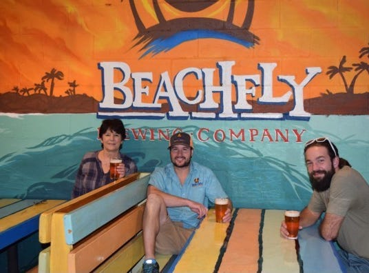 OPEN: Lisa Freismuth and her son Zach Featherstone, owners of BeachFly Brewing Company along with brewmaster Will Brant.