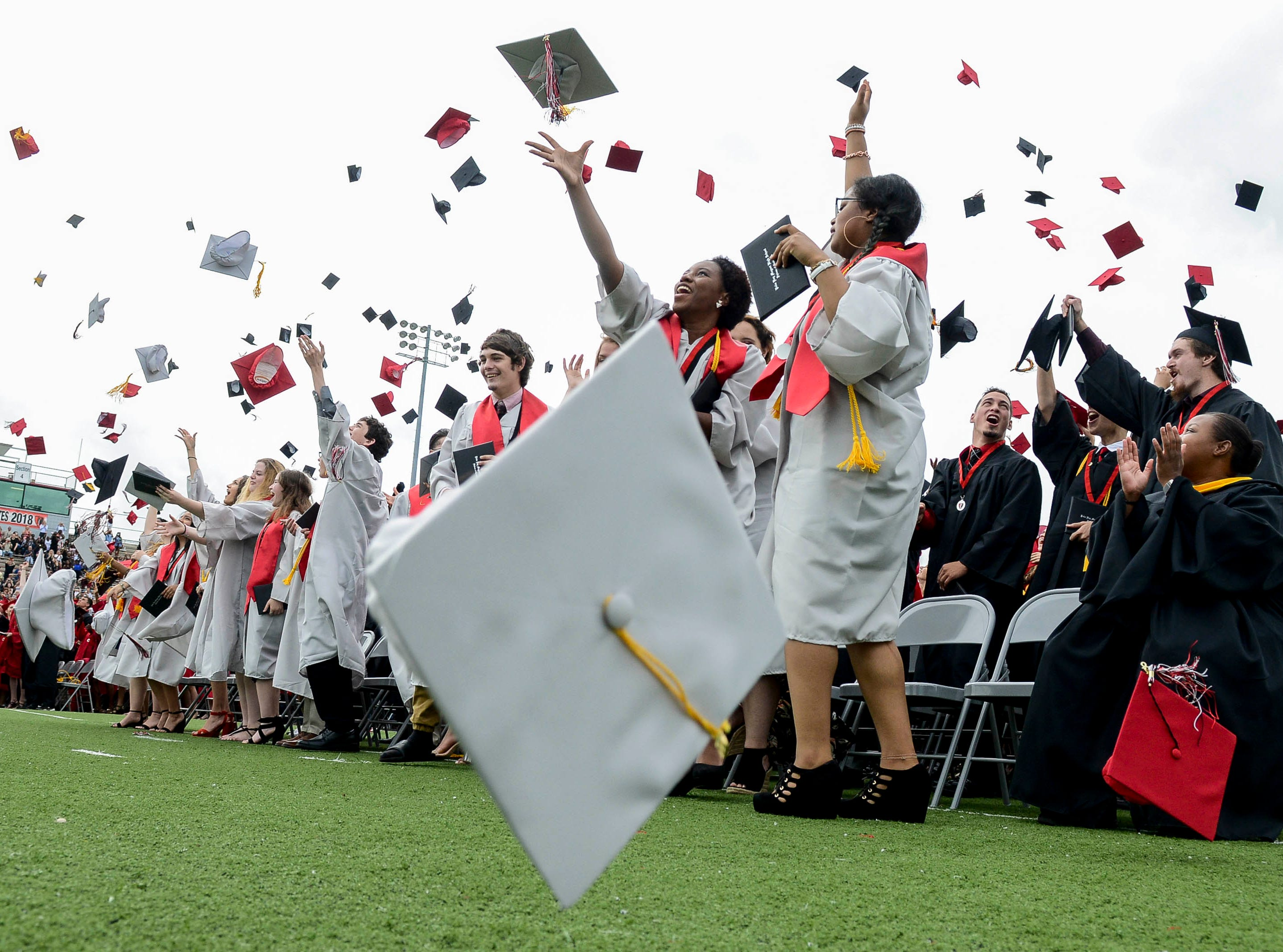 Seniors in the Palm Bay Magnet High Class of 2018 cross the stage to receive their diplomas under cloudy skies Saturday morning.