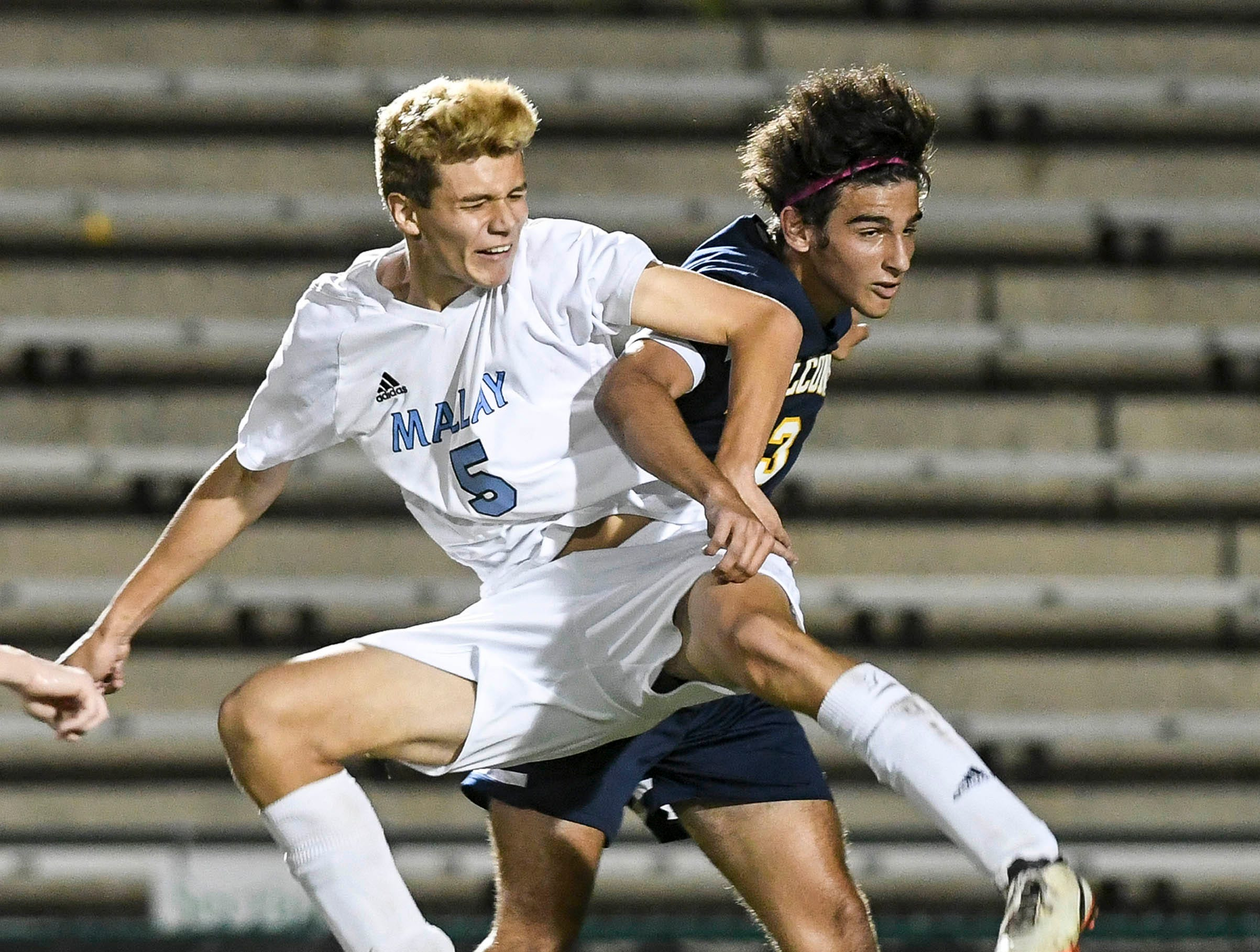 Alex Guzman of Maclay and Marco Campiani of Palmer Trinity battle for the ball in the air during Thursday's Class 1A boys state soccer final.