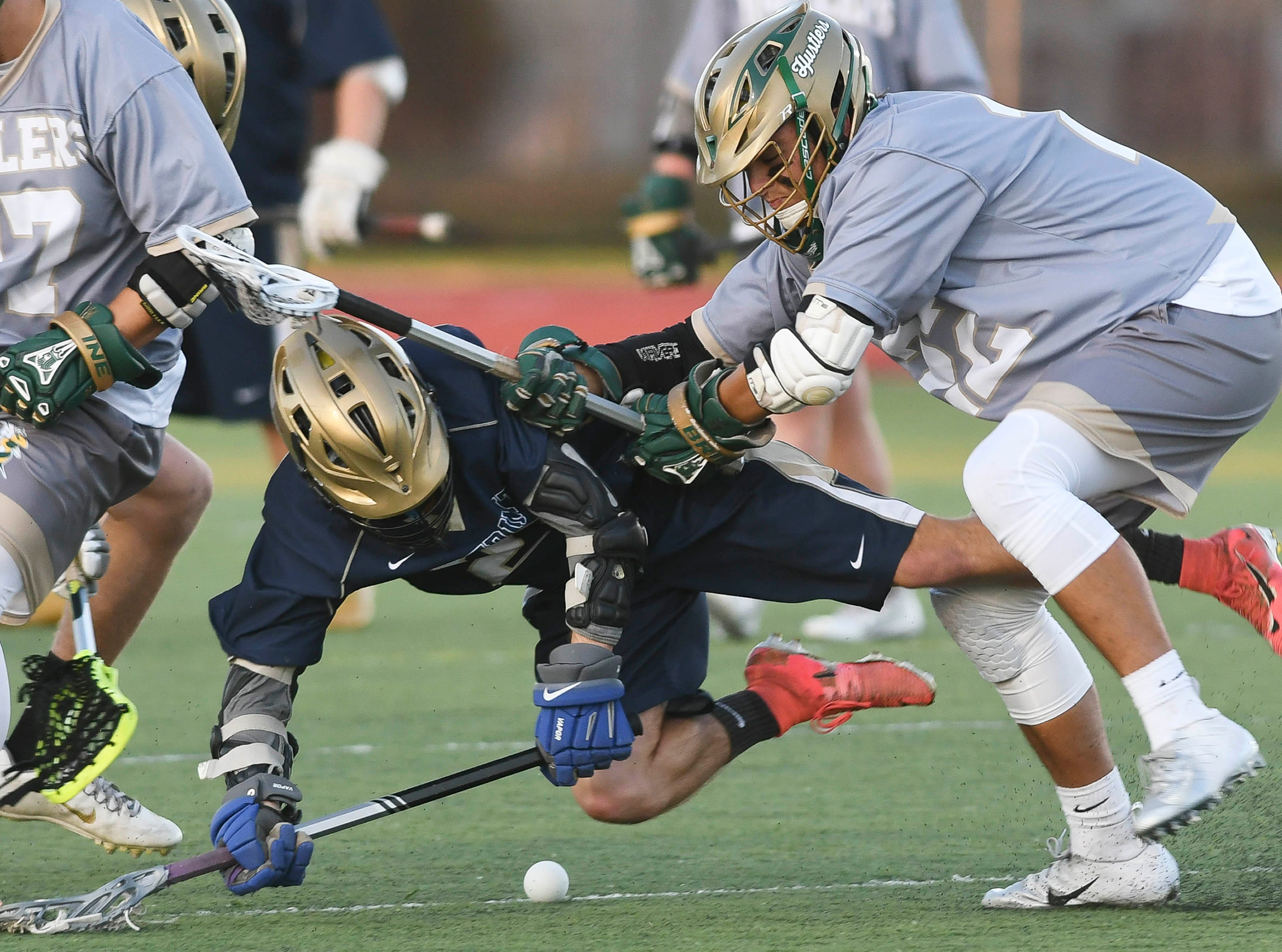 Hunter Gaskin of Holy Trinity and Nolan Penn of Melbourne Central Catholic collide during Friday's game.