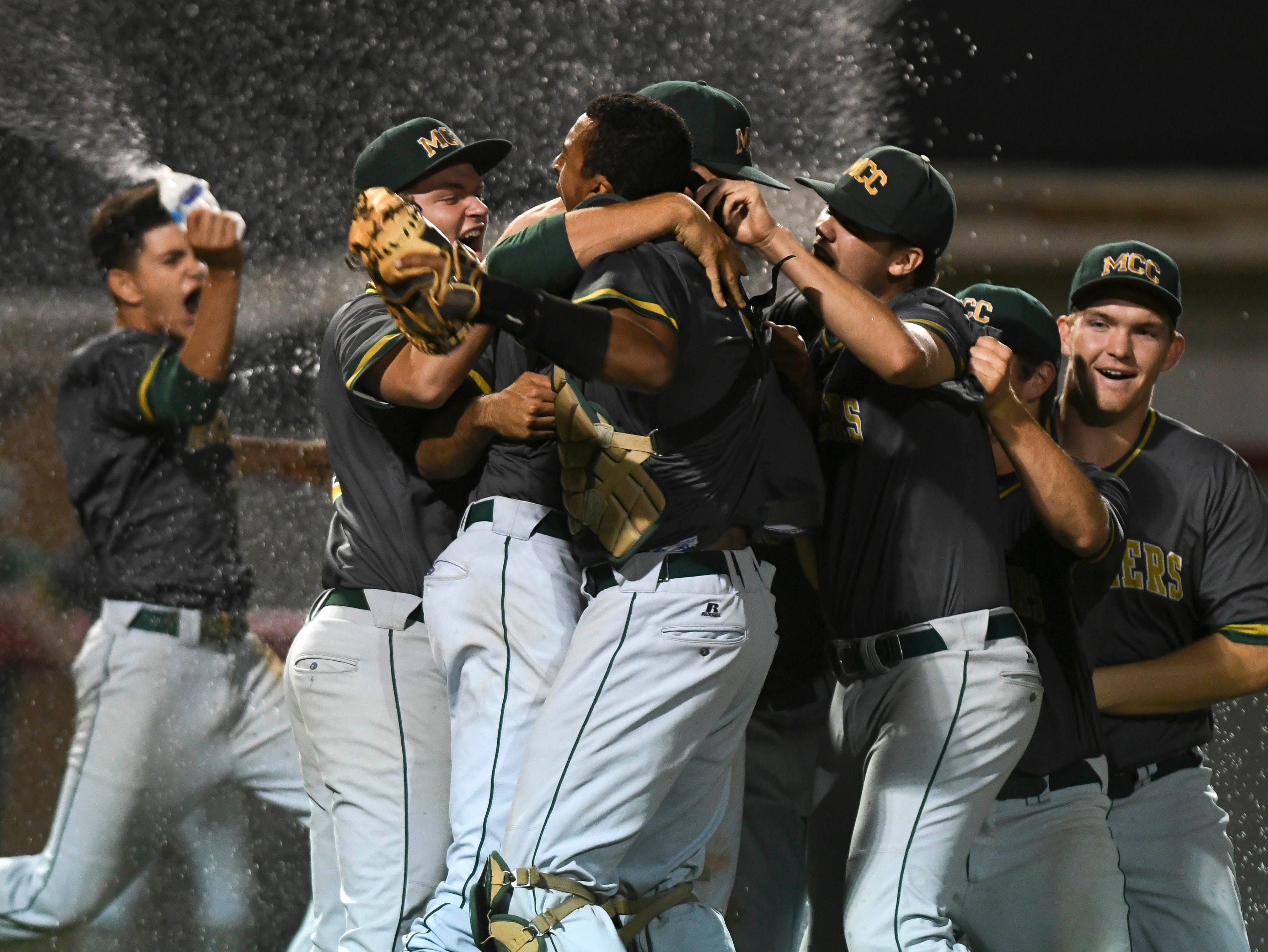 Melbourne Central Catholic players celebrate their 1-0 victory over Satellite in Friday's 9-5A baseball championship game.