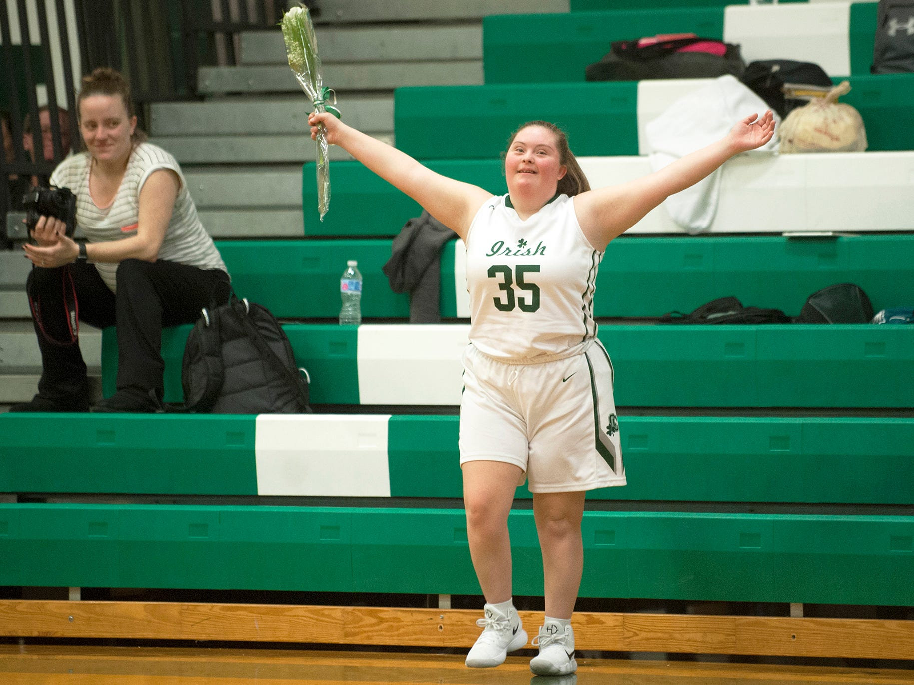 Kate Spadaro,  a senior at Camden Catholic High School with Downs Syndrome, is introduced prior to a varsity girls basketball game between Camden Catholic and Lenape, played at Camden Catholic High School in Cherry Hill on February 15, 2018.  Spadaro, who has been a basketball player, manager, cheerleader and arguably the team's biggest supporter during her four years at Camden Catholic, was announced as one of the five starters and scored a basket during the first quarter of the game.