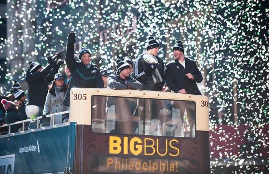Confetti falls as Eagles quarterback Carson Wentz, Eagles back-up quarterback Nate Sudfeld, Super Bowl MVP Nick Foles and Eagles owner Jeffrey Lurie ride a float during the PhiladelphiaEagles Super BowlLIIvictory parade in Philadelphia on February 8, 2018.