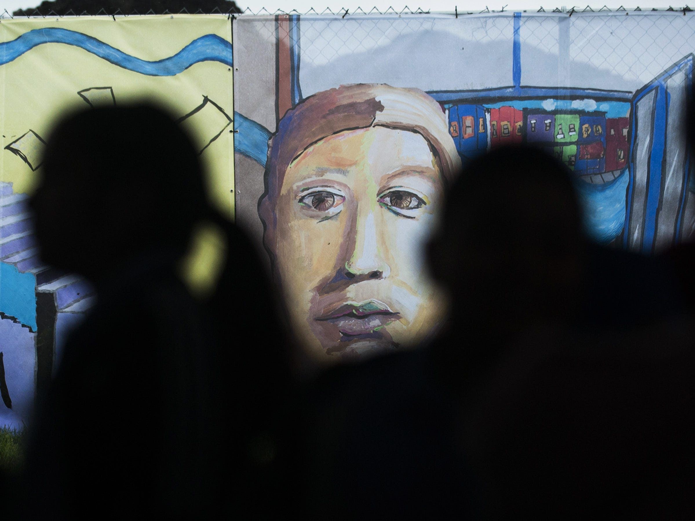 "Camden students attend an unveiling ceremony for a 685-foot mural entitled ""Camden, Past. Present. Future."", that was created by the students and was displayed on the construction fencing at the Camden Waterfront development site on May 18, 2018."